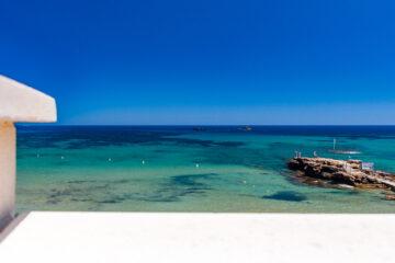 Mauer mit Meer  Platja es Figueral Balearische Inseln - Ibiza Spanien by Peter Ehlert in Ibiza - Insel des Lichts